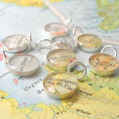 A great idea.  Charms made from maps that represent your travels!
