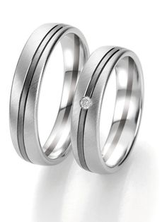 Eheringe in Graugold-Weißgold: -   Ringbreite: 5,0 mm -  Kollektionen: Fifty Rings Of Grey -  Steingröße & Qualität: ges. 0,03 ct w/si -  Material: Graugold-Weißgold -  Ringhöhe: 1,8 mm -  Oberfläche: mattiert, glänzend -  Lieferzeit: 7-10 Werktage