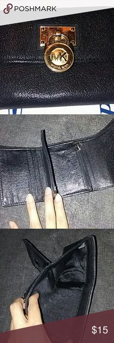 Used mk bi fold wallet Black and gold authentic mk wallet the mk medallion has stracthes see first pic but inside and the outside leather in mint condition. KORS Michael Kors Bags Wallets
