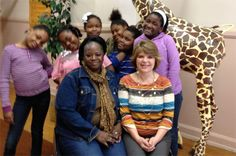Clarke Street School students show their appreciation of their school secretaries Denise Reed (seated, left) and Mary Kay Eul (right) on Administrative Professionals Day.