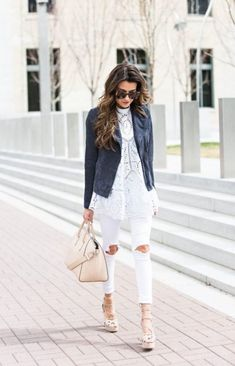 Large ripped holes in the knee give way for a flash of flesh while wearing an elegant lace top. Gorgeous. | How to Wear White Jeans this Summer - 16 Stylish Outfits