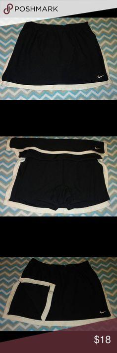 Black Nike Dri-Fit Skort Skirt Great Condition!!! Dri-Fit. 92% Nylon/ 8% Spandex. Black with white trim. SIZE XS (0-2) Nike Skirts