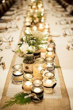 Centros de mesa con tarros de cristal y velas