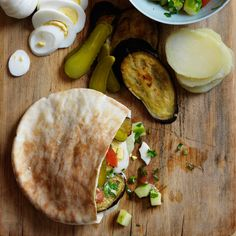 This terrific vegetarian sandwich - a mix of tender eggplant, potato, egg, hummus and pickles - is based on an Iraqi-Israeli classic.