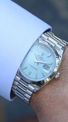 Ice Ice Baby. This elegant, yet modern take on the #RolexPresident Day-Date Men's Watch features a platinum case, smooth bezel and baby blue dial with a diagonal motif. Rolex Watches For Men, Rolex Day Date, Presidents Day, Baby Blue, Sapphire, Smooth, Ice, Jewels, Crystals