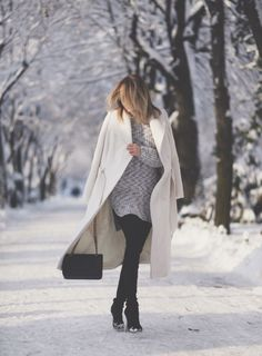 85f245de29 Winter Outfit Ideas  Silvia Postolatiev is wearing a white long coat from  Marks   Spencer
