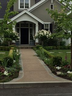 Layering with boxwoods - could do this along sidewalk to front door.