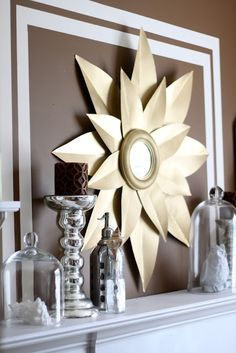 Homemade Starburst mirror using a small round mirror, cardboard, and gold spray paint.