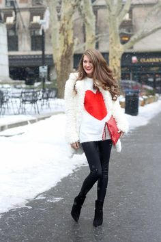 Valentine's Day Outfit - fuzzy heart sweater, faux white shearling coat, black leggings, black wedge booties, red clutch