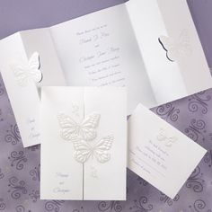 These two embossed butterflies white wedding invitations are perfect for a spring wedding! http://www.thepartyblock.com/butterflyweddinginvitations.htm