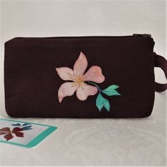 Small wristlet clutch with appliqued clematis design Clematis Plants, Clematis Flower, Aubergine Colour, Occasion Bags, Romantic Evening, Dance The Night Away, Luxury Bags, Soft Suede, Applique Designs