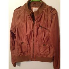 Brown leather jacket Light brown faux leather jacket with zipper pockets and water resistant material! Very comfortable, but the sleeves are too short for my long arms! Xhilaration Jackets & Coats