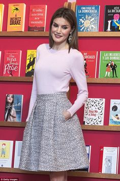 Queen Letizia looked chic a blush pink round neck sweater and a grey tweed Fifties-style skirt as she attended the Madrid Book Fair today