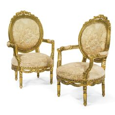 A pair of Louis XVI style carved giltwood and tapestry upholstered armchairs French, early 20th century