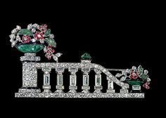 Platinum, diamond, cabochon ruby, carved emerald, jadeite and enamel brooch of a staircase with balustrade and vases of flowers at the top and at the bottom of the steps. French (Bourdier) c.1928.