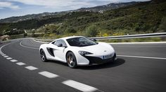 McLaren 650S Coupe 2014, Dynamic Side-Front 3/4 Shot. More Images & Info On The Following Link: https://www.carspecwall.com/mclaren/super-series/650s-coupe-2014/