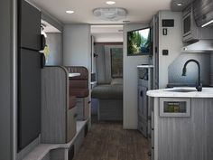 The Lance 3445 Travel Trailer comes with a large dinette, and plenty of counter space! Light Travel Trailers, Lance Campers, Rv Show, Rv Accessories, Grey Furniture, Construction Design, Truck Camper, Rv Living, Beautiful Lights