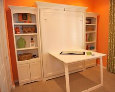 Murphy bed / Craft space for spare room. Perfect for a multipurpose room!! This thing is awesome, and would be perfect for the niche in the room without the bookshelves on either side!