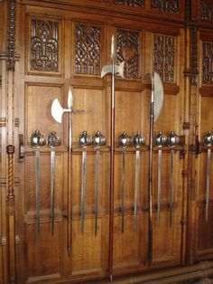 Polearms and basket-hilted swords in the Great Hall of Edinburgh Castle. The polearm on the right is a Lochaber axe; the other two are halberds.