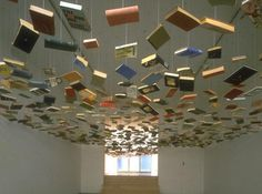 If I don't cull the herd soon, I'm going to have to start hanging books from the ceiling too.  ;)