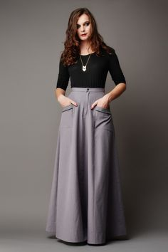 High-waisted maxi skirt. Version A is buttoned at the front with belt hoops. Version B has a fly front zipper and patch pockets. The pattern envelope contains a full size pattern and a detailed instruction booklet. This pattern is fully bilingual (french/english).