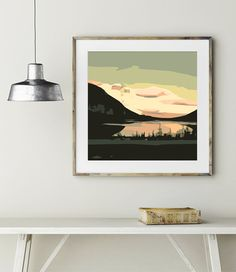 Evoke a sense of serenity with this unique modern art print. Capturing the tension between dark rugged mountains and the gentle pink sky reflecting off