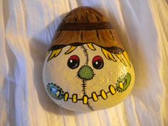 34 Rock Painting Ideas for Halloween and Fall A slumbering fox is a perfect fall painted rock. A cozy campfire is featured on this painted rock. Autumn Painting, Pebble Painting, Pebble Art, Stone Painting, Scarecrow Painting, Painted Rocks Craft, Hand Painted Rocks, Painted Stones, Painted Pebbles