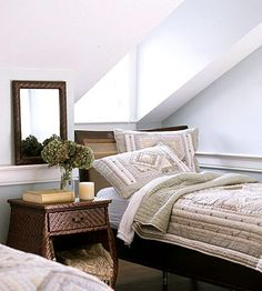 """Enjoy Extra Headroom """"Placing twin beds directly beneath these double dormers puts floor space to use in a functional and comfortable way that wouldn't work without the window addition. Cutting into the cathedral ceiling opens up the space, lets in light, and eliminates the risk of accidental head bumps on the ceiling when getting out of bed."""""""