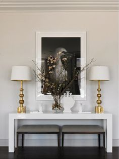 Samantha Todhunter - contrast the colour of console table with the colour of th ebenches, also I would use black frame for the painting and white based painting.