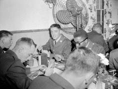 """""""Pvt. Elvis Presley puts away a meal of fried fish and french fries after his arrival at Fort Hood on March 28, 1958, to begin eight weeks of basic military training in the 2nd Armored Division."""" ASSOCIATED PRESS FILE PHOTO  