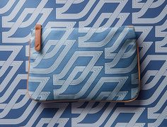 """[Business Class] Air France These business class amenity kits—referred to as """"Comfort Kits"""" in the airline's lingo—were introduced in February 2015. The zip-top bags each feature a bold retro pattern outside—in four available colors—with Clarins skincare products inside. Some of the kits are lined with historic images from the airline's past, too."""