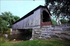 Mull Covered Bridge: An 1842 Town lattice bridge reaches 100 feet across the East Branch of Wolf Creek on County Road 9-0 near Old Fort, Ohio. Renovated in 1990. Open only to foot traffic.