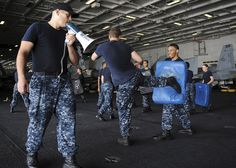 NORTH ARABIAN SEA (July 23, 2013) Master-at-Arms 2nd Class John Kuchler, from Pleasantville, Utah, instructs Sailors for patrol training in the hangar bay of the aircraft carrier USS Nimitz (CVN 68). Nimitz Strike Group is deployed to the U.S. 5th Fleet area of responsibility conducting maritime security operations, theater security cooperation efforts and support missions for Operation Enduring Freedom. (U.S. Navy photo by Mass Communication Specialist 3rd Class Chris Bartlett/Released)