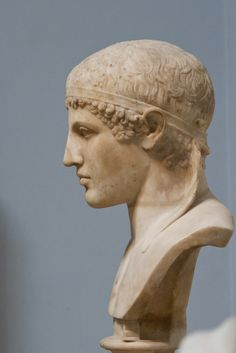 """Head of an athlete wearing a """"taenia""""; the head was originally part of a full-length statue but was added to a modern bust by its restoer. The head is either modeled on a Greek original of about 470 -460 BC or is a new Roman creation in a Classicising style. (Source Museum WEB Site)  Roman marble sculpture 1st century BC or AD London, The British Museum  