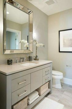 Vanity paint color is Sherwin Williams SW 7673 Pewter Cast. Guest Bathroom Remodel, Bathroom Renos, Grey Bathrooms, Bath Remodel, Beautiful Bathrooms, Small Bathroom, Master Bathroom, Bathroom Mirrors, Budget Bathroom