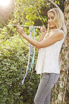 Lauren Conrad poses with a bow and arrow in new Kohl's shoot #dailymail
