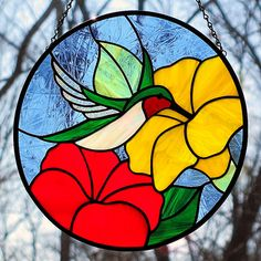 Stained Glass Hummingbird Suncatcher Red Yellow Flowers. $85.00, via Etsy.