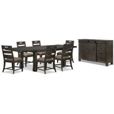 Bring a rustic, forest atmosphere to your dining room with this Calistoga eight-piece dining package. From top to bottom, each item is built using thick pieces of solid pine. The wood is then finished in a weathered charcoal colour and adorned with aged iron metal accents for a look as easy to admire for its beauty as its creativity. The matching server features nearly a dozen storage spaces for your dining accessories, as well as a sliding barn door to continue the rustic theme.