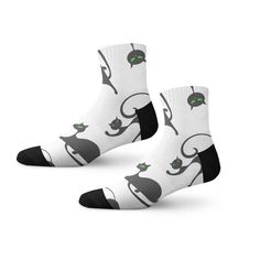Showcase your cat love with these fun socks. Black cat with magnetic green eyes gracing the white backdrop is sure to brighten up your day!