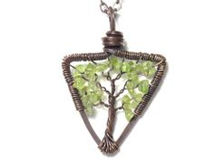 The Triangular Tree of Life Antiqued Copper Necklace in Peridot.. $52.00, via Etsy.