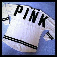 New! PINK varsity sweatshirt New with tags, this sweatshirt is long and loose fitting! Thick material and very comfy! PINK Victoria's Secret Tops Sweatshirts & Hoodies