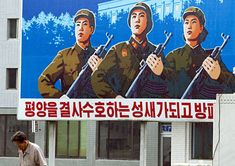 North Korean Propaganda: Many communist countries' propaganda artwork has similar themes and North Korea's is no different. Subjects such as a leader's cult of personality, military might, utopian society and devotion to the state are common, and most North Korean billboards carry slogans rather than advertisements. (Eric Laffourgue/Gamma-Rapho) Late North Korean leader Kim Jong Il is credited with mythologizing the Kim family and making its identity inseparable from the country's.