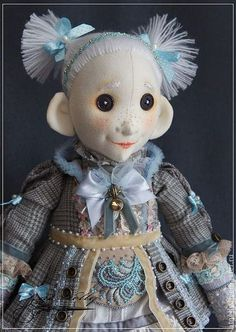 handmade doll..unusual.. i like the eyes made out of buttons and the pigtails..