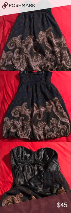 Guess Dress Very sexy and comfortable dress, perfect for a nice out or a formal event. Has built in cups in the breast area. Only worn a few times and in great condition. Size 3. Guess Dresses Mini