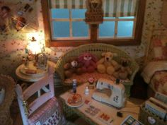 A view of my dollhouse cottage workroom/bedroom