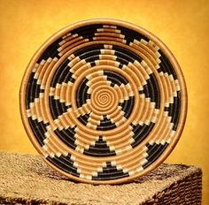 """Rwandan Handcrafted 12"""" Sisal and Sweet Grass Hope Basket. $39.99 via https://rwandabasketsr.3dcartstores.com/ This design, inspired by the sun-burst symbol on the Rwandan flag, is close to the hearts of the weavers we partner with. With each basket the women sell, their hope for a brighter future becomes more of a reality."""