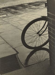 Herbert List  1903 Hamburg – 1975 Munich  Bicycle on the corner, Hamburg. Circa 1930 Vintage. Gelatin silver print. 28,3 × 20,8 cm (11 ⅛ × 8 ¼ in.)