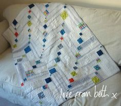 Love this modern quilt ... mostly neutrals with a smidge of brights.