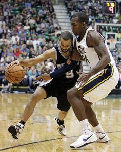 Utah Jazz forward Paul Millsap (24) defends against San Antonio Spurs point guard Tony Parker (9) in the second quarter during an NBA basketball game, Wednesday, Dec. 12, 2012, in Salt Lake City.  (Rick Bowmer / Associated Press) / SA