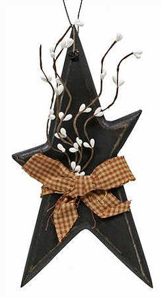 """10"""" Primitive Star with Pip Berries and Homespun Ribbon  $2.99  Item# wd2095  Complete your primitive country theme with this classic black wood star accented with pip berries and a homespun checked bow. Add a proud touch to any wall, or other special place in your country primitive home.     This item is completely finished and painted as shown in the photo. No further assembly of any kind is required."""